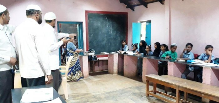 Children are taught in the dining hall, owing to a lack of classrooms at the Government Urdu Primary School, in Banakal.