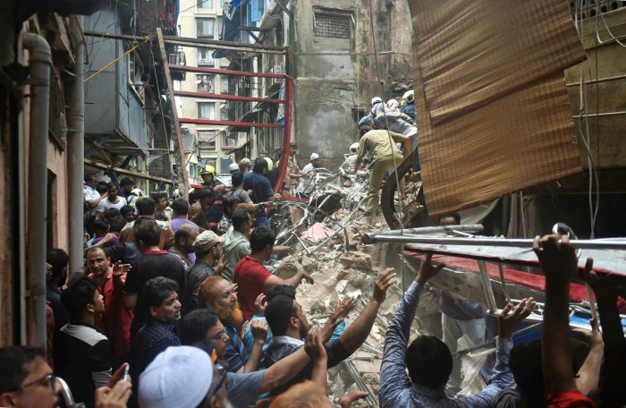 Rescue and relief work underway after the collapse of the four-storey Kesarbai building at Dongri in Mumbai. (PTI Photo)