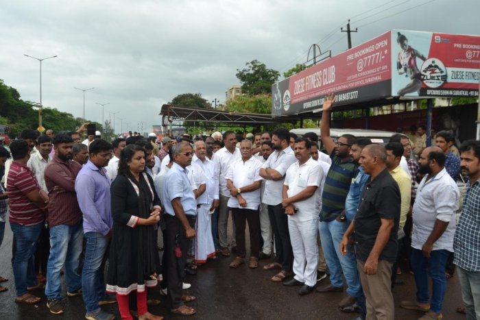 Members of the Toll Gate Virodhi Horata Samithi stage a protest near the Surathkal toll gate on Tuesday.