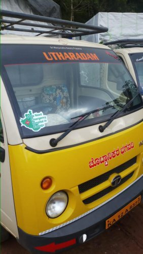 A sticker supporting the campaign for an emergency hospital in Kodagu pasted on a vehicle in Mahadevpet.