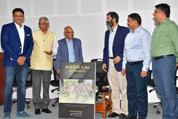 "Releasing a book — 'Wildlife Law for Rangers', by conservationist Praveen Bhargav of Wildlife First at Chitrakala Parishat, Kumble said, ""We have enough laws to protect our precious flora and fauna. But due to lack of knowledge and poor interpretation of the rules, many fail to exercise them. In this context, the new book will be handy for the field officials to deal with the forest offences and wildlife crime."" (DH Photo)"