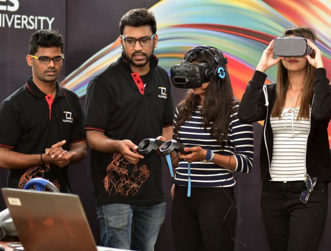 Students use Google Cardboards at the launch of Academic AR/VR Centre of Excellence on Tuesday. DH photo/Ranju p