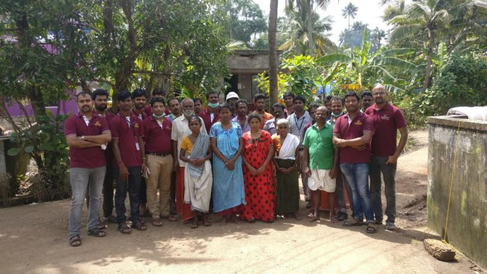 The team at Ollur village in Kerala after ligting up 150 homes