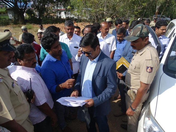 Deputy commissioner of Bengaluru Urban district B M Vijayashankar carried out eviction drive in various taluks of the district and reclaimed 25.26 acres of government land.