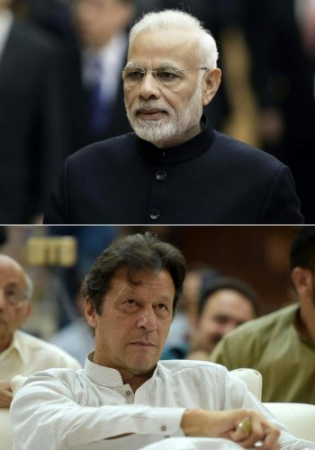 A combination of file pictures of Prime Minister Narendra Modi and Pakistan Prime Minister Imran Khan. AFP