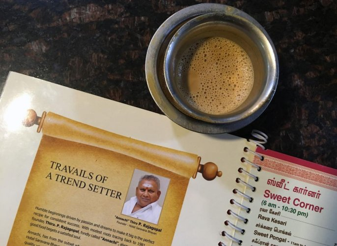 A file photo shows the image of P. Rajagopal, founder of the Saravana Bhavan food chain, on a menu at one of the popular restaurants in Chennai. (AFP)