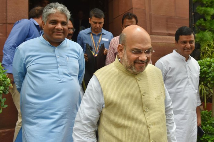Union Home Minister Amit Shah with BJP MP Bhupendra Yadav during the Budget Session at Parliament, in New Delhi on July 10, 2019. PTI