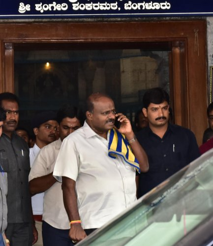 Chief Minister H D Kumaraswamy comes out of the Sringeri Shankar Mutt after offering prayers with his family in Bengaluru on Wednesday. DH Photo/Krishnakumar P S