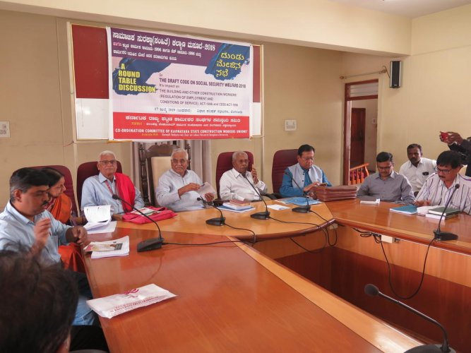 Trade unionists, activists and former officials discus the centre's new draft code on Social Security Welfare (2018) at the Legislator's Home (Council) in Bengaluru on July 17, 2019.From left: Mahantesh (secretary, CITU), Kathyayini Chamaraj (social acti