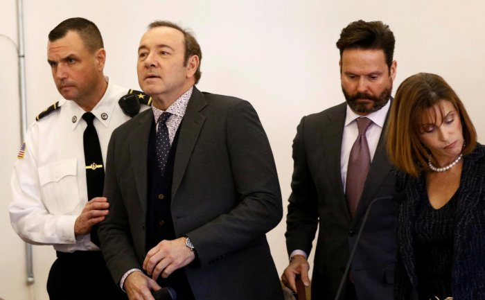 FILE PHOTO: Actor Kevin Spacey, with his lawyers Alan Jackson and Juliane Balliro at his side, is arraigned on a sexual assault charge at Nantucket District Court in Nantucket, Massachusetts, US. Reuters file photo