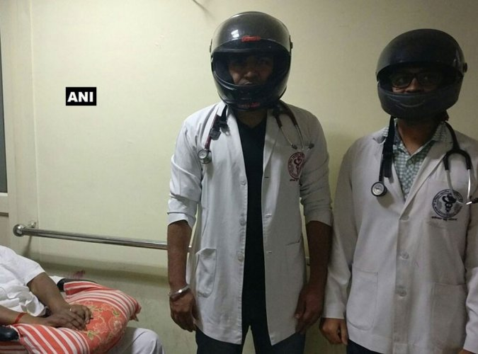 AIIMS resident docs wear helmets in support of strike in Maharashtra