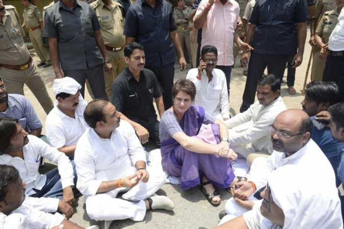 Congress General Secretary Priyanka Gandhi Vadra sits in protest on the roadside, after she was stopped from proceeding to Sonbhadra to meet victims of clash that claimed 10 lives, in Mirzapur. (PTI Photo)