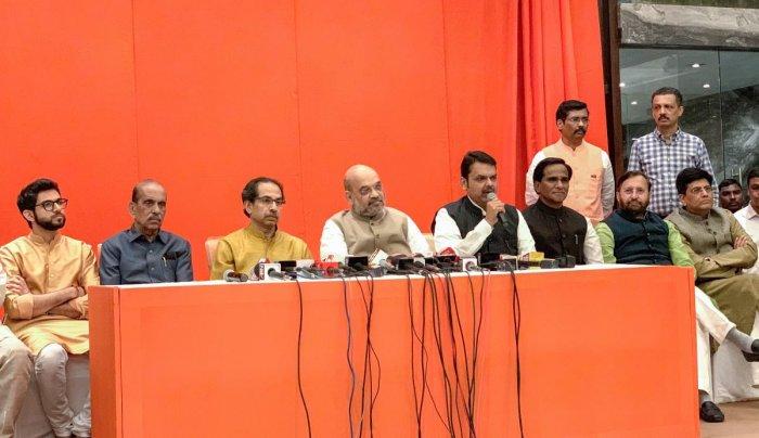 Maharashtra Chief Minister Devendra Fadnavis announces an alliance between Shiv Sena and BJP for Lok Sabha and Assembly polls, in Mumbai, Monday, Feb 18, 2019. Also seen are (R-L) Union Ministers Piyush Goyal and Prakash Javadekar, state BJP chief Raosaheb Danve, BJP President Amit Shah, Shiv Sena President Uddhav Thackeray, former state chief minister Manohar Joshi and Sena youth leader Aditya Thackeray. (PTI Photo)