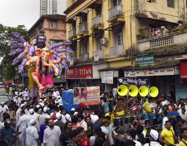 Devotees carry a Ganesha idol to be installed at a pandal ahead of Ganpati festival, in Mumbai on Sunday. PTI