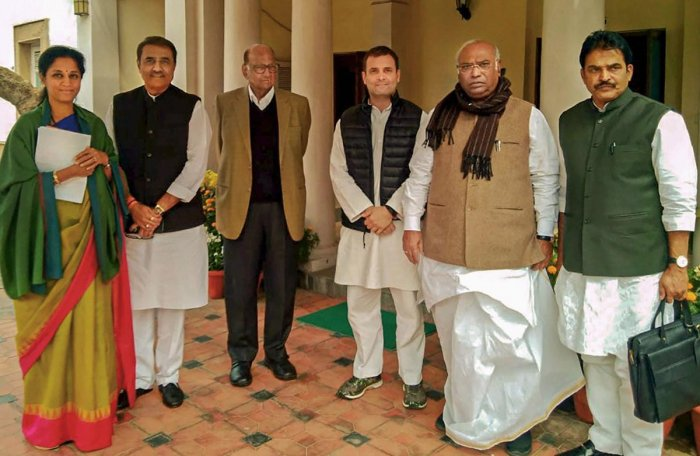 Nationalist Congress Party president Sharad Pawar, Congress president Rahul Gandhi, senior Congress leaders Mallikarjun Kharge, K C Venugopal, NCP leaders Supriya Sule and Praful Patel at former's residence, in New Delhi on February 13, 2019. PTI