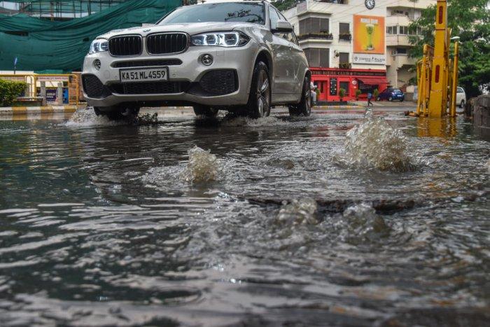 An overflowing manhole on Vittal Mallya Road. DH FILE PHOTO