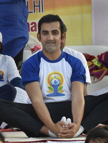 New Delhi: BJP MP from East Delhi Gautam Gambhir performs yoga on the 5th International Day of Yoga, in East Delhi, Friday, June 21, 2019. (PTI Photo/Manvender Vashist)(PTI6_21_2019_000005A)