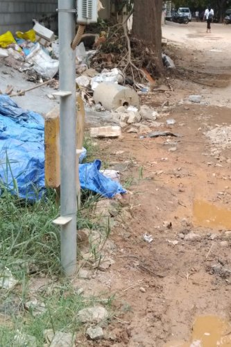 The construction debris and garbage dumped on roads in AECS Layout. Special arrangement