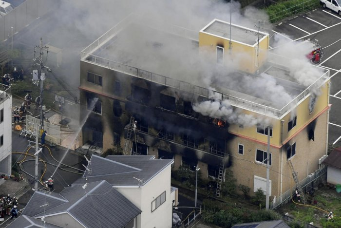 An aerial view shows firefighters battling fires at the site where a man started a fire after spraying a liquid at a three-story studio of Kyoto Animation Co. in Kyoto, western Japan, in this photo taken by Kyodo. Reuters