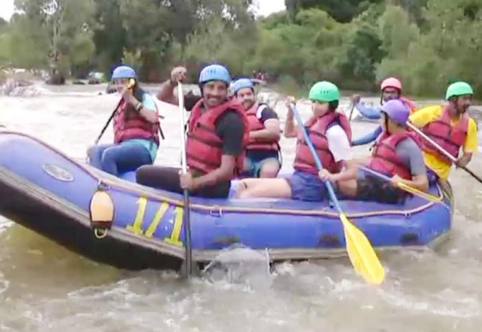 Tourists go rafting in River Cauvery at Dubare.