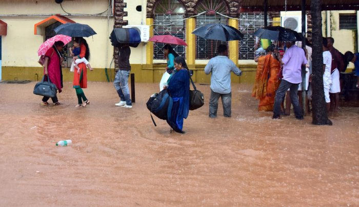 Passengers seen wading in ankle-deep water after Mangaluru Central railway station witnessed unprecedented water-logging on Thursday.