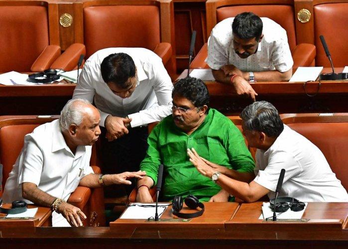 Leader of the Opposition B S Yeddyurappa, BJP leaders R Ashoka, Jagadish Shettar and Ashwathanarayan discuss a point during the Assembly session in Vidhana Soudha on Friday. DH Photo