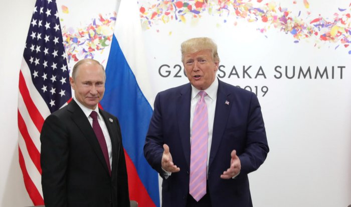 Vladimir Putin and Donald Trump attend a meeting on the sidelines of the G20 summit in Osaka, Japan (Reuters File Photo)