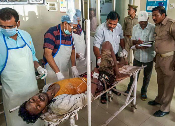 An injured being brought to a hospital in Varanasi, Wednesday, July 17, 2019. Nine people were killed and 20 others were injured in a property dispute in Sonbhadra district after a gunfight between two groups. Photo/PTI