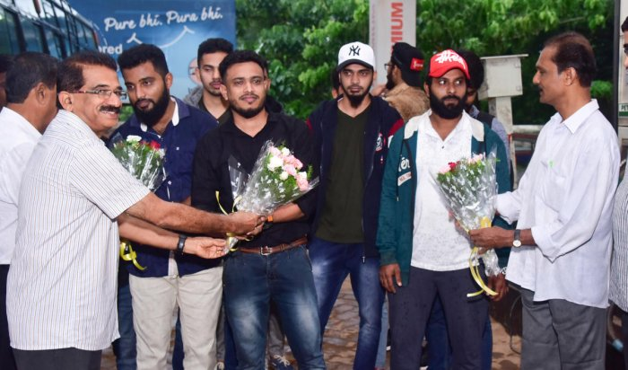 The job fraud victims, who returned from Kuwait, were welcomed in Mangaluru on Friday.