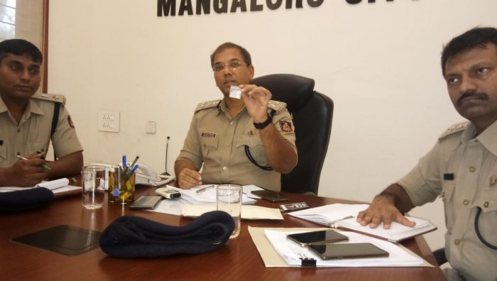 City Police Commissioner Sandeep Patil shows the packet of illicit drug, seized during the raids in Mangaluru.
