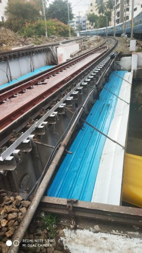 The extended safety screen of the rail overbridge at Sivananda Circle.