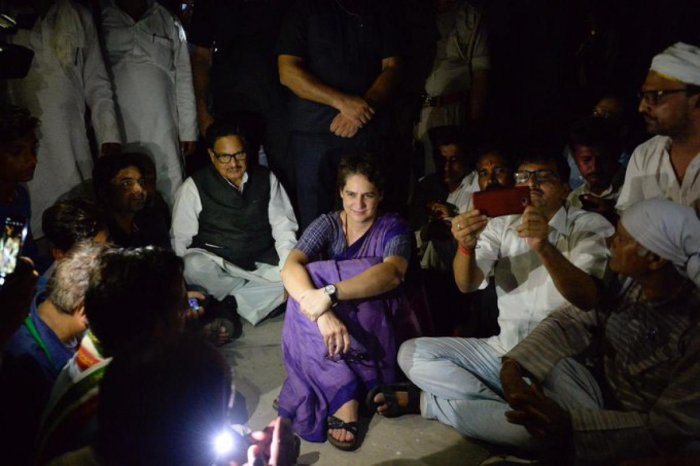 Congress General Secretary Priyanka Gandhi Vadra sat on a dharna at Chunar Fort Guest House , after she was placed under detention when she was on her way to Sonbhadra, where 10 people were gunned down this week, in Mirzapur (PTI Photo)