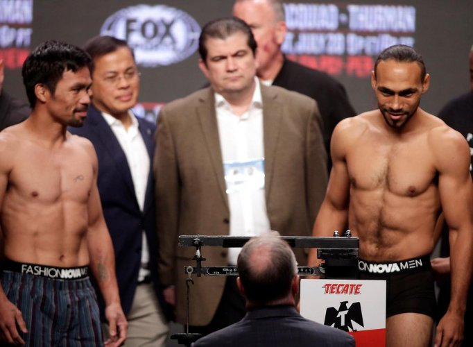 Boxers Manny Pacquiao (L) from the Philippines and Keith Thurman (R) from the USA face off during their weigh-in on July 19, 2019, at the MGM Grand Hotel and Casino in Las Vegas, Nevada. - The fighters will meet on July 20th in a WBA super world welterwei
