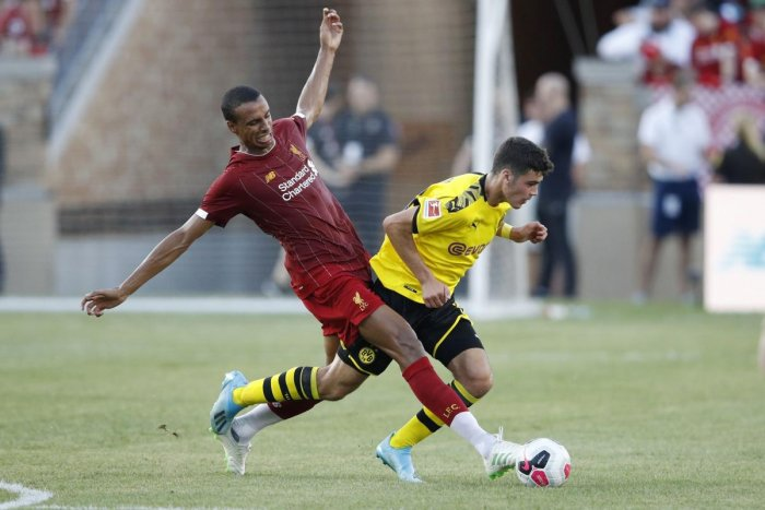 Joel Matip of Liverpool FC fights for the ball against Ömer Toprak #36 of Borussia Dortmund in the first half of the pre-season friendly match against at Notre Dame Stadium on July 19, 2019 in South Bend, Indiana. Joe Robbins/Getty Images/AFP
