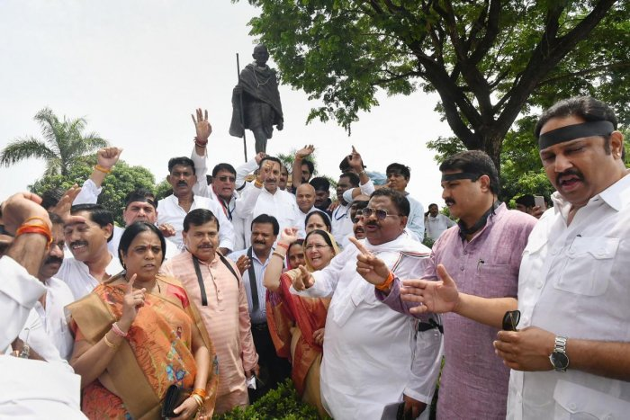 Madhya Pradesh ministers and Congress MLAs protest outside Madhya Pradesh Assembly after Priyanka Gandhi was stopped from proceeding to Sonbhadra to meet victims of clash that claimed 10 lives by Uttar Pradesh police, in Bhopal. PTI Photo