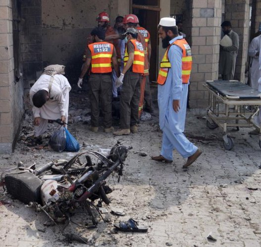 Dera Ismail Khan: Pakistani security officials and rescue workers gather at the site of a bombing on an entrance of a hospital in Dera Ismail Khan, Pakistan, Sunday, July 21, 2019. Police in Pakistan say gunmen opened fire on a police post and then bombed the entrance to a hospital as the wounded were being brought in.AP/PTI
