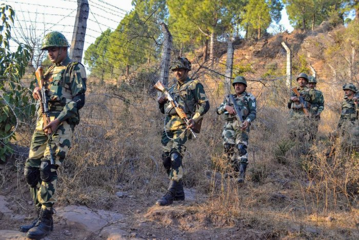 Poonch: Border Security Force (BSF) jawans patrol near Line of Control (LoC) in Poonch on Monday. PTI Photo (PTI2_19_2018_000200A)