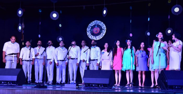 Conductor, Pianist Shubira D'Sa (right) leads 'Poco-A-Poco's' talented amateur vocalists and musicians at Sri Sudhindra Auditorium in Canara Girls High School on Saturday.