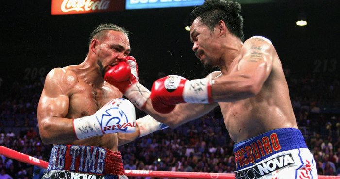 Filipino boxer Manny Pacquiao (R) slams a right to the face of US boxer Keith Thurman during their WBA super world welterweight title fight at the MGM Grand Garden Arena on July 20, 2019 in Las Vegas, Nevada. - Pacquiao won a 12 round split decision. (Pho