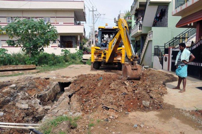 The incomplete work on underground drainage at Gandhinagar in Chikkamagaluru.