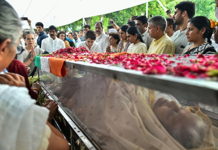 Congress Parliamentary Party chairperson Sonia Gandhi pays her last respects to the mortal remains of former Delhi chief minister Sheila Dikshit at the AICC headquarters in New Delhi (PTI Photo)