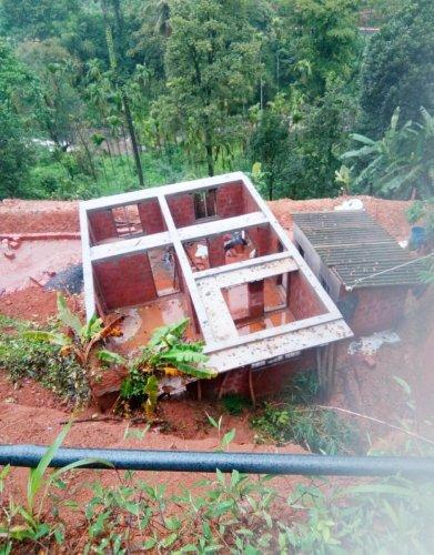 A hillock caved in on an under construction house at Jodupala, Kodagu, on Sunday.