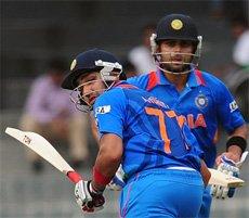 Kohli, Sharma propel India to 185/3 against Pakistan