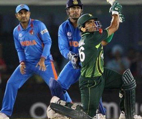 Akmal scores ton to steer Pakistan to 248 for eight