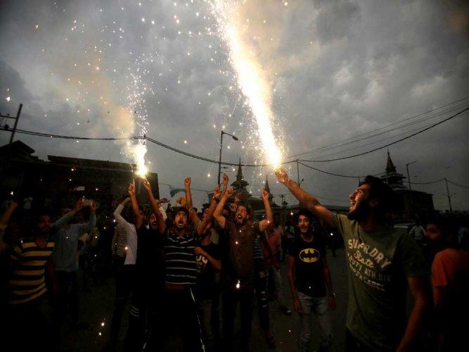 Kashmiris celebrate Pakistan win over Indian in CT final