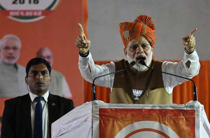 Prime Minister Narendra Modi addresses an election rally poll-bound Rajasthan's Hanumangarh.(Photo: Suman Sarkar)