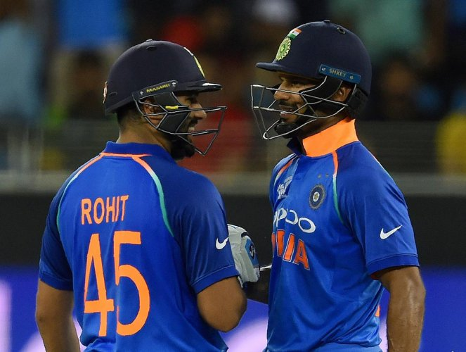 Indian cricket team captain Rohit Sharma (L) and teammate Shikhar Dhawan greet each other during the one day international (ODI) Asia Cup cricket match between Pakistan and India at the Dubai International Cricket Stadium in Dubai on September 19, 2018. (AFP Photo)