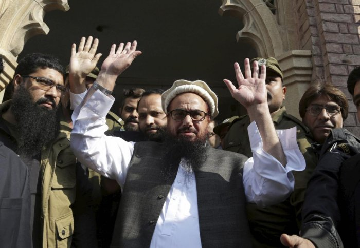Hafiz Saeed, head of Jamaat-ud-Dawa, waves on his arrival to a court in Lahore on November 21, 2017. AFP