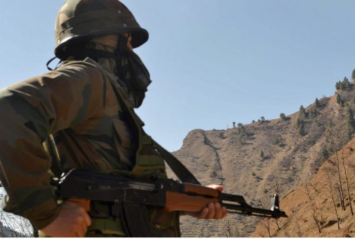 An army jawan keeps vigil after ceasefire violations by Pakistan along the LoC. PTI File Photo