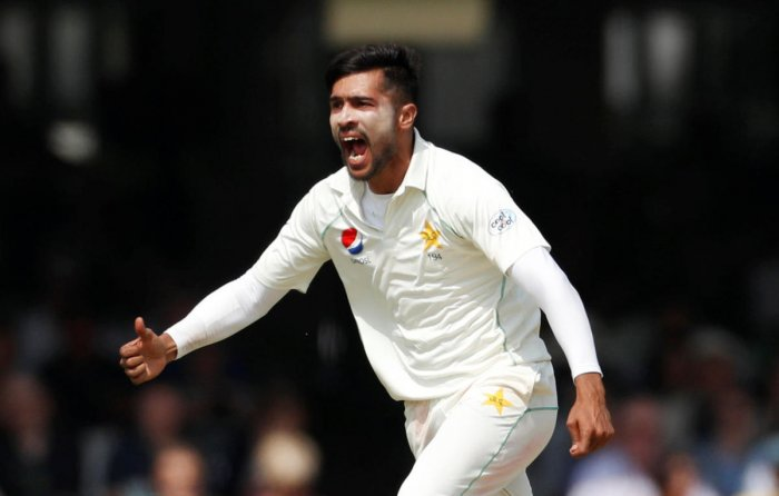 SWINGING AND SEAMING Pakistan's Mohammad Amir celebrates the dismissal of England's Dawid Malan on Saturday. Reuters